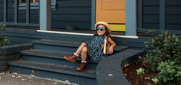 girl on stairs with sunglasses